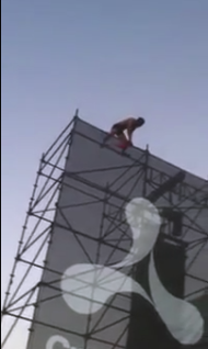 Guy Climbs A 60-Foot Scaffolding At Music Festival (VIDEO)